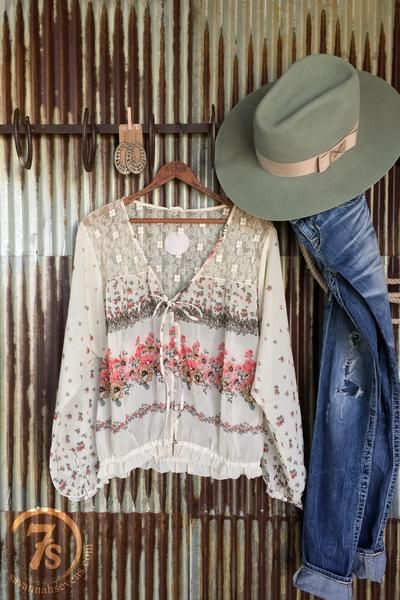 The Spring Valley - Spring floral sheer top.Embroidered sheer yoke front and back.Broken floral pattern.Ivory chiffon with sage and rose pattern.Long sleeve with button cuffs.V-neck.Cloth button front.Front tie.Elastic gathered waist.Soft, slightly flowy and romantic.
