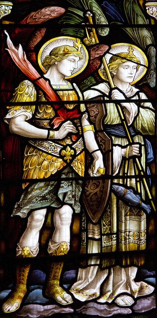 St Michael and St Raphael, detail from the east window of Holy Trinity Church in Stratford-upon-Avon.