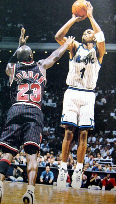 Penny Hardaway shoots over Michael Jordan