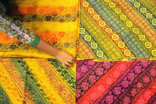 A worker displays traditional batik Jakarta