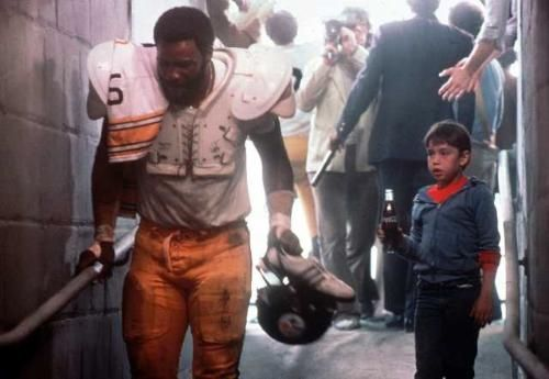 "Former Pittsburgh Steelers star ""Mean"" Joe Greene and child actor Tommy Okon in the 1979 Coca-Cola commercial."