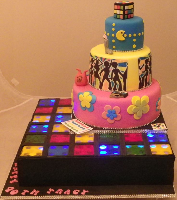 60's, 70's and 80's Themed cake - Lemon cake, chocolate cake and coconut cake.  Dance floor is made with isomalt squares with flashing lights