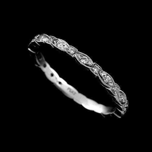 Vintage, slim band with diamonds https://www.etsy.com/uk/listing/157940548/950-platinum-thin-vintage-style-pave-set