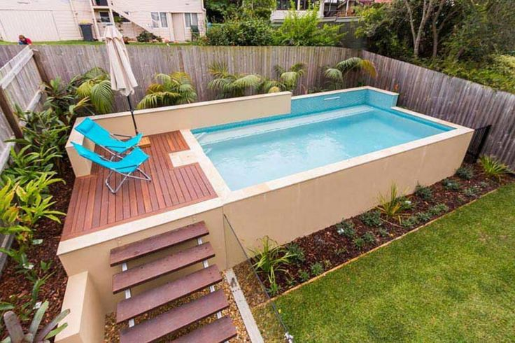 Backyard small above ground swimming pool eye catching for Above ground pool decks for small yards