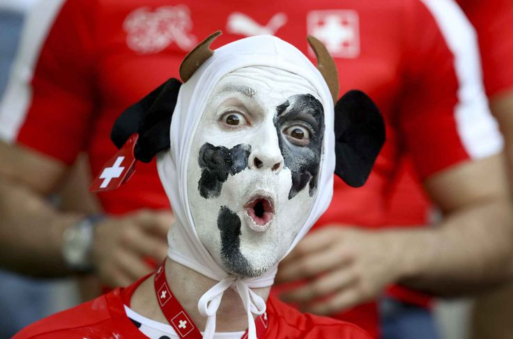 A Swiss fans cheers prior to the Euro 2016 round of 16 soccer match between Switzerland and Poland, at the Geoffroy Guichard stadium in Saint-Etienne, France, Saturday, June 25, 2016. (AP Photo/Thanassis Stavrakis)/FP101/802220199976/1606251434