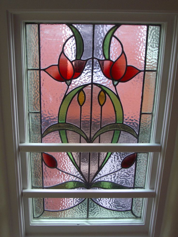 Restored Art Nouveau window on staircase
