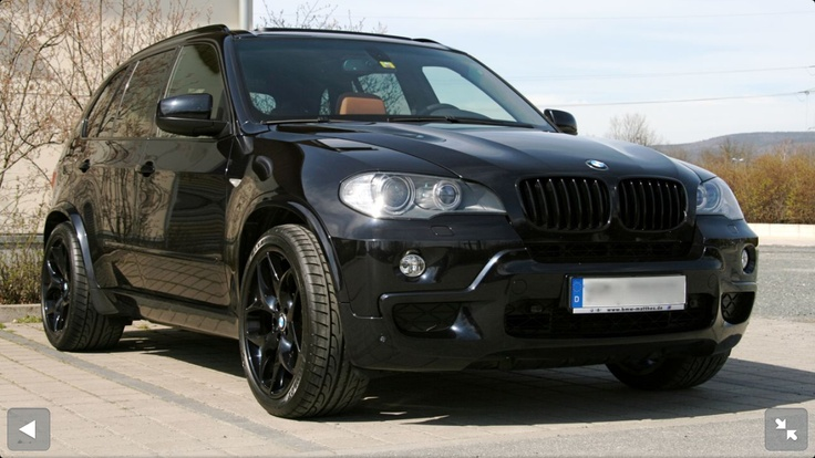 "Black Grill, dark tint, low profile tires, 20"" black BMF's"