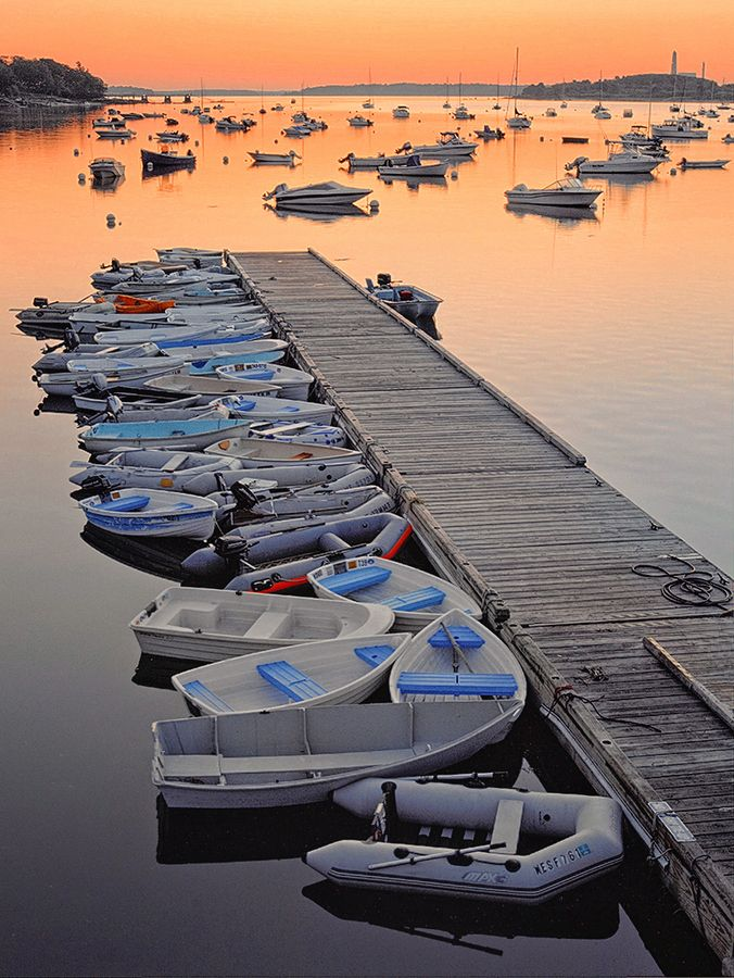 The sunset is so nice you almost don't notice that the dinghies are rather utilitarian downeast in Falmouth.