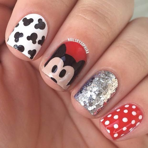 Image via  Lovely Cartoon Themed Nails for the Week   Image via  Mickey Mouse Nails | Airbrushed nails   Image via  Mickey Mouse nail art   Image via  Mickey mouse Disney nail art c