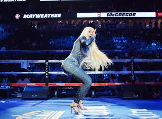 """Cardi B - Mayweather McGregor Performance  Cardi B's Mayweather McGregor performance broke the Internet. """"Bodak Yellow"""" continues to get more popular and the song is making Cardi rich. Media outlets report that Cardi was paid $1 million to perform at Floyd Mayweather and Conor McGregor's weigh in. The video at the end of this article shows Terrence J enjoying Cardi's performance.  Is Cardi B Engaged to Offset?  Did Offet put a ring on it? No officially but the Internet thinks the Migos…"""