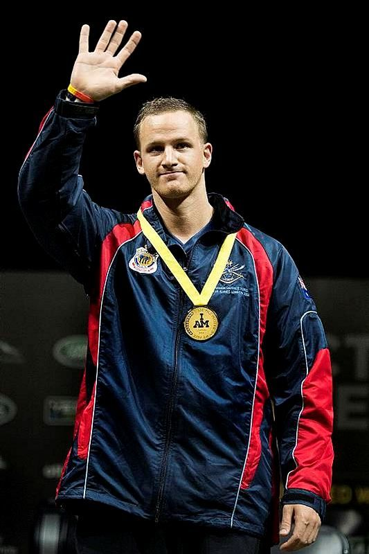 Australian Army Lance Corporal Craig Hancock of the 1st Armoured Regiment in Darwin shows off his gold medal for the rowing event at the Invictus Games in London on September 14.