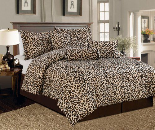 """Ad for leopard comforter. I like the soothing, complimentary colors for decorating with leopard print...off white walls, wood floor, taupe, the """"right"""" brown."""