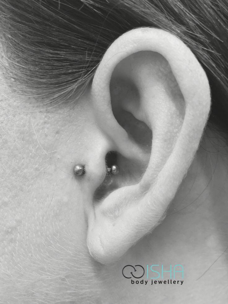 Fresh tragus piercing by Emma at Black Rose Tattoo Studio.