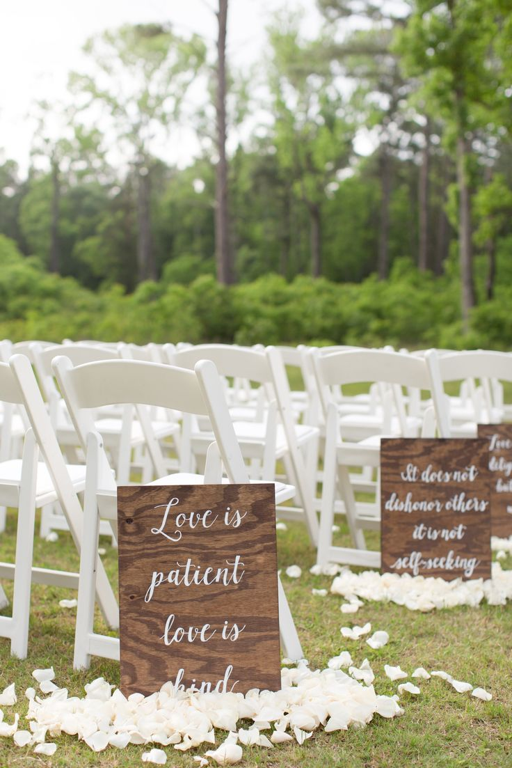 Private Texan ranch wedding with the ceremony in an open field with the trees as…