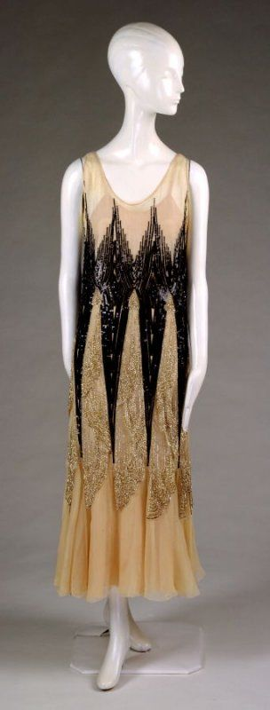 Dress: cream silk georgette embroidered with black and silver beads sequins Date: ca. 1929
