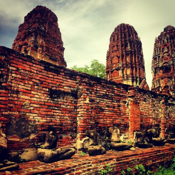 Ruins of Ayutthaya in Thailand and ransacked bodies of Buddha
