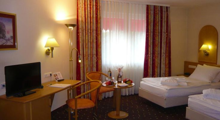 Hotel Rheinsberg am See Berlin This non-smoking hotel is located in the Märkisches Viertel district of Berlin, just 1 km from Wittenau Underground Station. It offers a country-style restaurant, free WiFi in all areas, and free parking.