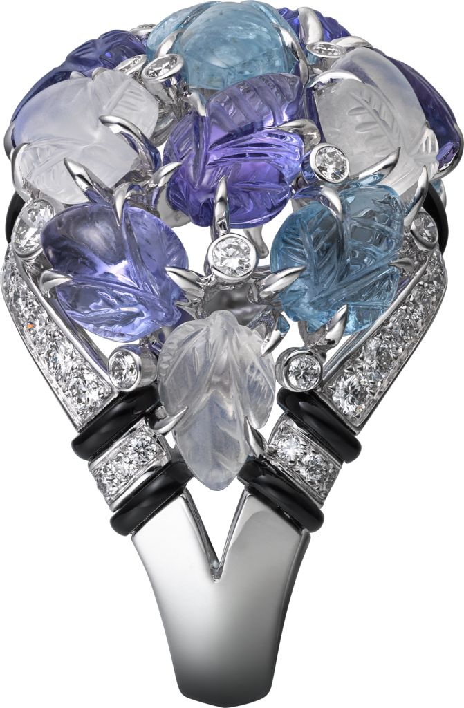 CARTIER. Ring with engraved stones, 18K white gold, set with aquamarines, tanzanites, moonstones, onyx and 69 brilliant-cut diamonds totaling 0.97 carats. (P.R.P. $102,000) #Cartier #CartierMagicien #HauteJoaillerie #FineJewelry #Diamond #Tanzanite #Aquamarine #Moonstone #EngravedStones
