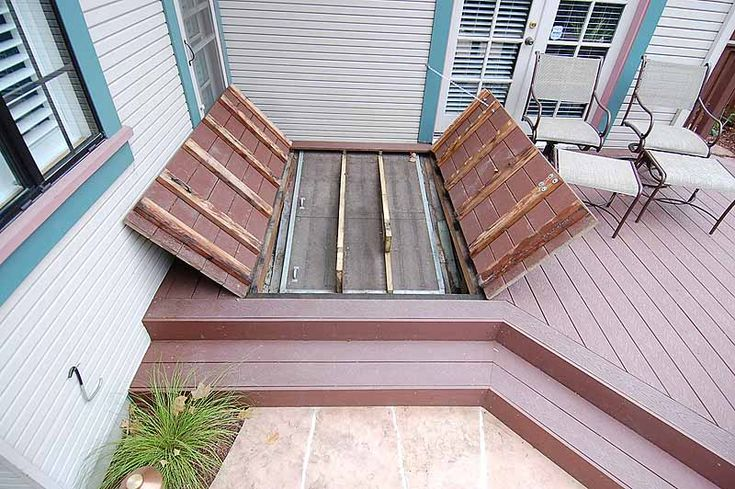 How to hide an ugly bulkhead basement door garden for Basement entry ideas