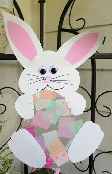 easy easter crafts for two year olds. bunny holding an easter egg suncatcher easy crafts for two year olds