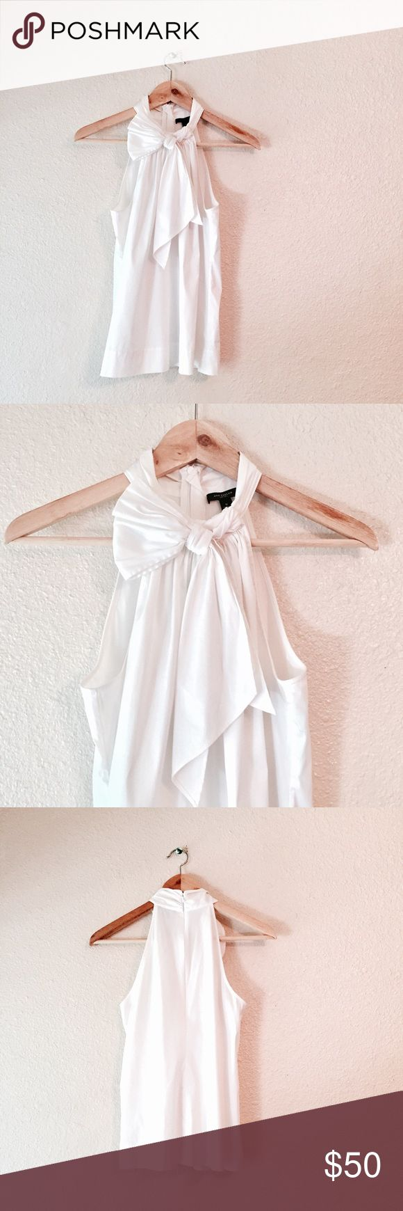 Ann Taylor white bow high neck tank top blouse 6 Beautiful Ann Taylor Sleeveless Blouse. Bright white high neck tank top. Lovely bow on the front. Excellent used condition. Very well made & extremely flattering! Size 6. Ann Taylor Tops Tank Tops