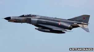 Turkey's government has called an emergency security meeting amid reports that one of its fighter jets was shot down by Syrian security forces.
