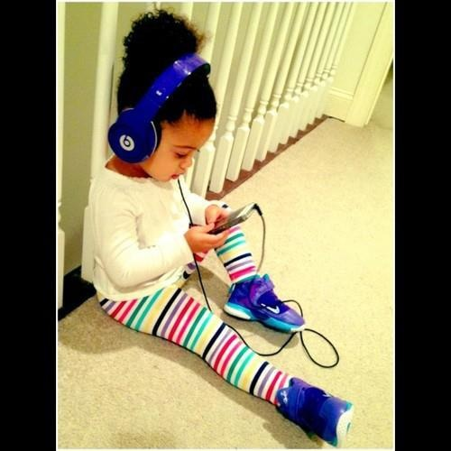 A Cute Little Girl with A Blue Beats by Dr dre Studio Headphone