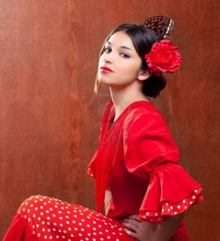 Flamenco dancer Spain woman gipsy with red rose and spanish peineta