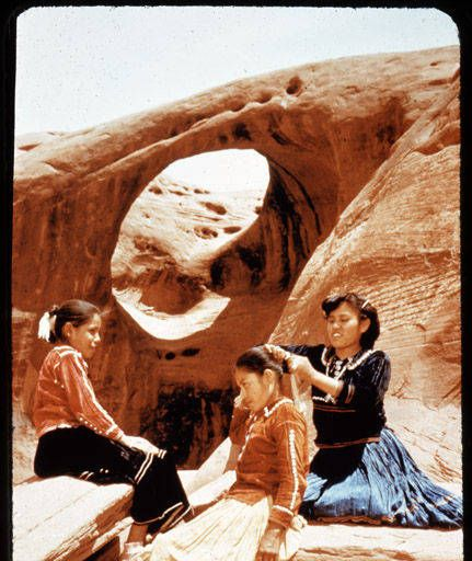Three Navajo Girls Fixing Hair, Monument Valley 1960's. Arizona Highways Magazine