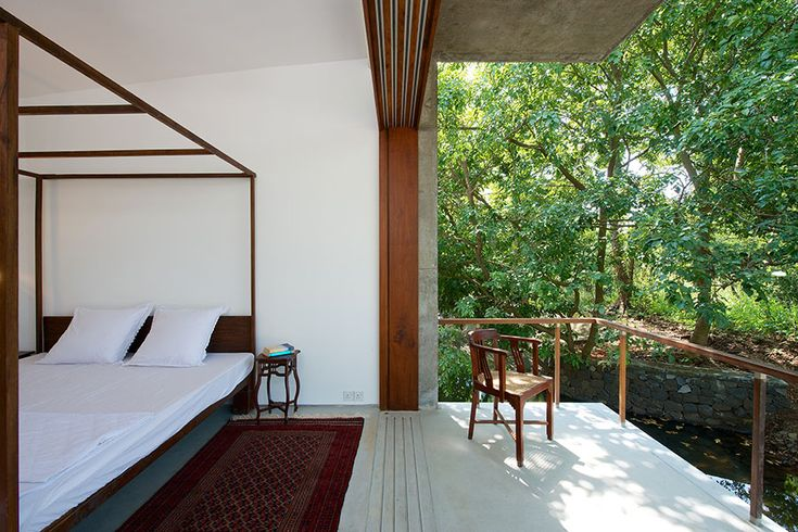 master bedroom verandah at House on a Stream #whitespaces #slidingwindows #weekendhome #verandah