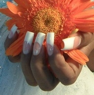 long fake french nails. blech.