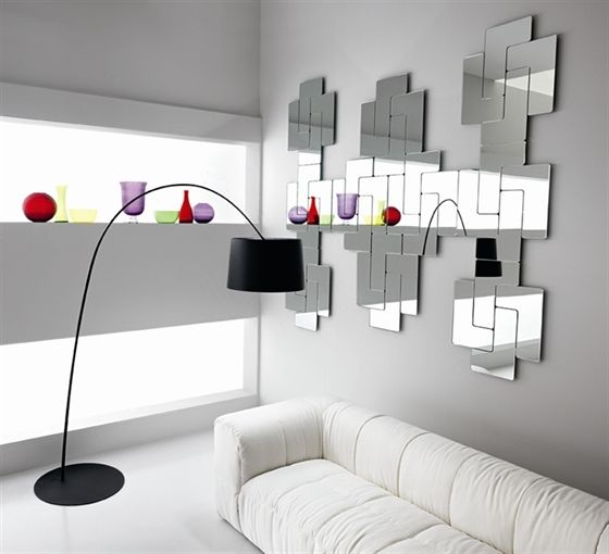FIAM tetrisdesign Julia Dozsa Set of modular mirrors that can be arranged to create a wide variety of graphic patterns, option of red coloured glass for combination with the silvered glass. The back of each module is fitted with magnets, which allow assembly of any graphic composition required. #ivit# Dimensions L.W.H. 80x66,5 cm 79,8x39,9 cm	 66,5x53,2 cm