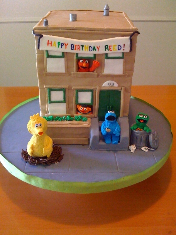 Great Sesame Street cake outside one of the apartment buildings. Now we just need to find a cake featuring Hooper's Store!