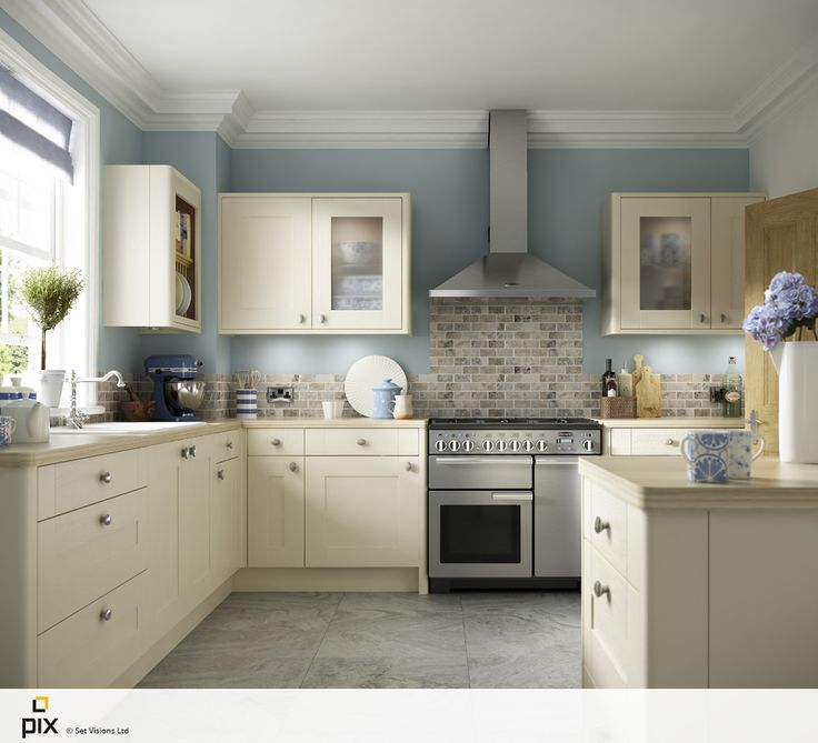 This painted cream shaker door sits with  Duck-egg walls and wooden worktops create a light, fresh feel in this country kitchen.Travertine mosaic tiles create a unique splashback, with slate flooring adding to the classic American New England look. Lifestyle photography by http://www.setvisionspix.co.uk/worktops create a light, fresh feel in this country kitchen. Pale blue kitchen accessories complete the look.