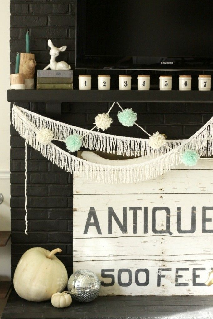 Pom Poms & Tassels with numbered jars on Thanksgiving mantle in black and white