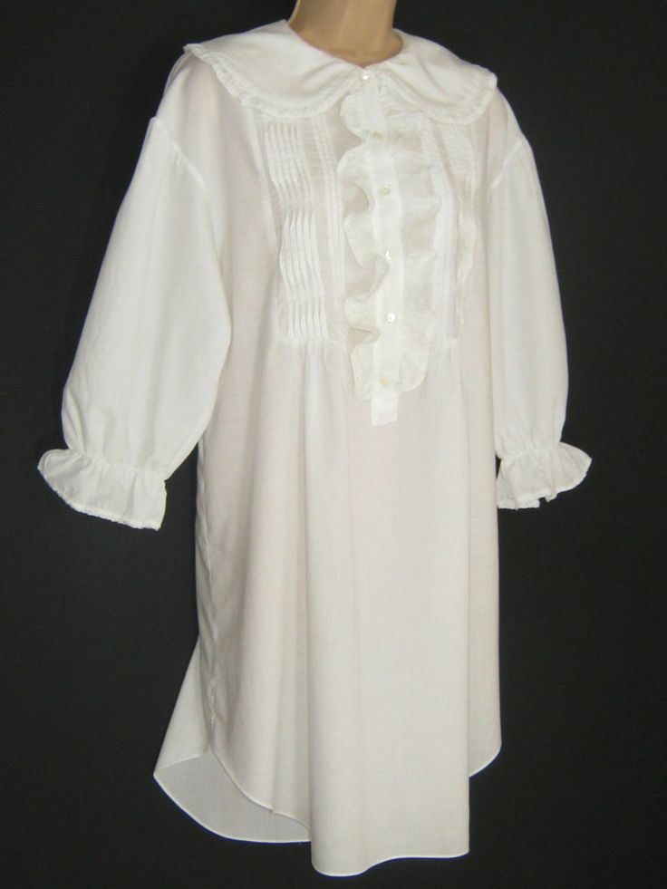 OVERSIZED DESIGN WITH CURVED HEM, THIS SHIRT FEATURES A MOST DISTINCTIVE SHAWL COLLAR WITH LACE EDGED RUFFLE TRIM. LONG SLEEVES GATHER NEATLY FROM OVERHANG SHOULDERS AND INTO ELASTICATED, LACE TRIMMED RUFFLE CUFFS.   eBay!