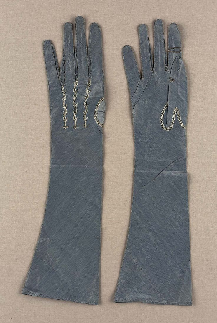 Pair of women's gloves, France, late 18th century. Changeable blue silk taffeta with white silk embroidery.