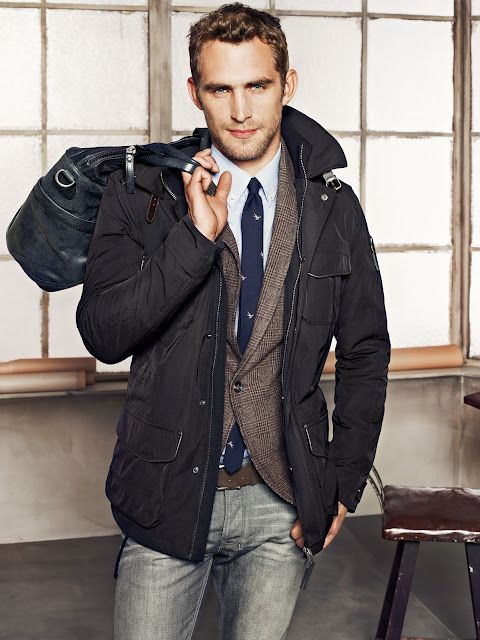 Men's fashion: Layered...Jeans are fine as long as they are not skinny jeans....and he's gotta lose the purse..for sure