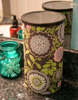 Paper covered oatmeal canister holds two rolls of toilet paper for the bathroom.