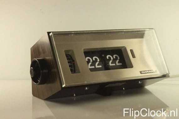 Beautiful and stylish woodgrain Garant flip-alarm-clock