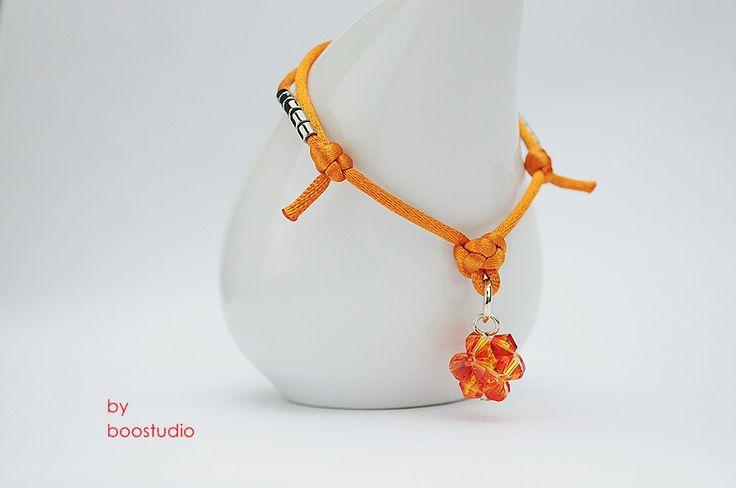 Satin cord bracelet - bransoletka z pomarańczowej satyny, ozdobiona kulką z kryształków Swarovskiego - BICONE - FIREOPAL. Dodatkową ozdobę stanowią japońskie koraliki MIYUKI. www.facebook.com/BooStudioHandMade