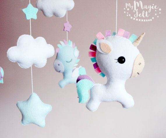 Baby mobile unicorn Baby mobile pegasus White baby mobile magic Crib mobile neutral nursery mobile Baby girl mobile Baby boy mobile ✂ MAKING TIME is 6 weeks ✈ Delivery time is 2-4 weeks depending on your location    ★.•* • . You want to make it in Personal Colors? Just write me . • *•.★        You can see My Felt Palette in the last photo  Baby mobile Includes: • unicorn - 2 pieces • pegasus - 2 pieces • cloud - 3 pieces • star - 1 piece • little flat star - 5 pieces       • • • • ● ● ●…