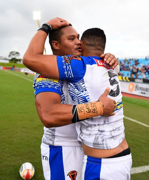 Matthew Wright of Samoa celebrates after scoring a try  with Canberra Raiders Joseph Leilua  during the 2017 Rugby League World Cup match between Samoa and Scotland at Barlow Park on November 11, 2017 in Cairns, Australia.