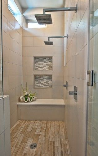 Love this large shower with bench with rustic blonde ceramic wood tile flooring