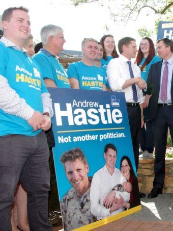 Federal Liberal MP Andrew Hastie has been terminated from the Army Reserve after he refused to remove photos of himself in his uniform from campaign material.