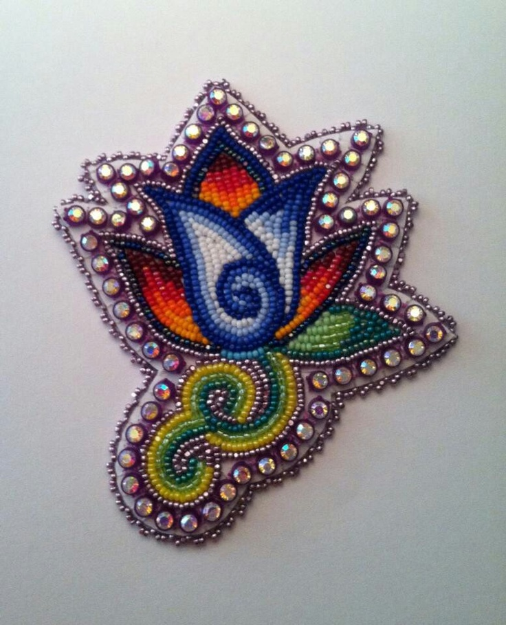 Creative beadwork earrings by Joseph Newman