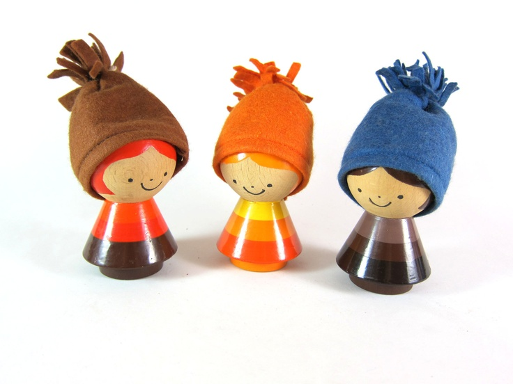 Mid Century Kay Bojesen Style Danish Turned Wooden Painted Little Boy and Girl Egg Cups with Winter Hat Cozies - Set of 3. $135.00, via Etsy.
