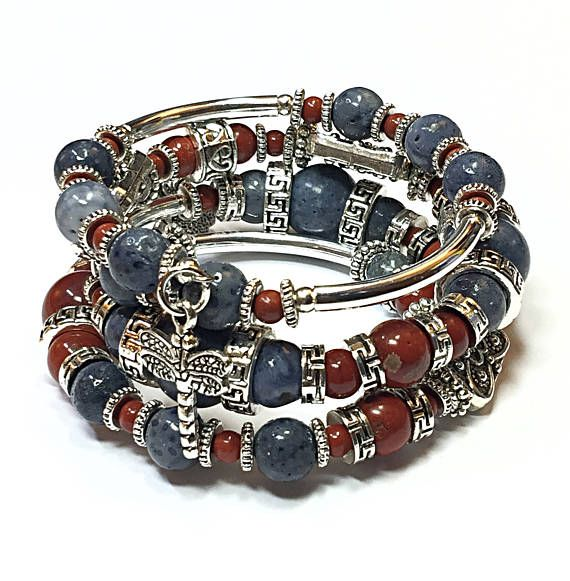 Make a powerful statement of style with this red and blue bracelet. This dragonfly bracelet is sleek and contemporary. The mix of red, blue and silver and button beads is rustic yet refined. This delectable memory wire bracelet blends dragonfly charms with red agate beads, blue