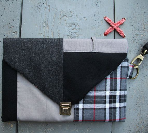 This 'eating the goober' handmade ipad case is made from recycled men's trousers combined with new textiles. Men's suit trouser pocket has been used on the back. It can also be used as a stylish envelope purse Colors: different shades of grey, black, white and red