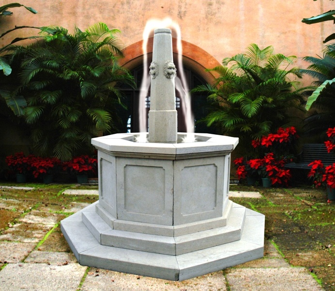 Hand carved grey sandstone fountain in the shape of a traditional well with four head spouts.  Please check the link below for profile with a photo in our premises in Marbella, Spain.